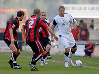 Photo: Leigh Quinnell.<br /> AFC Bournemouth v Swansea City. Coca Cola League 1. 14/04/2007. Swanseas Lee Trundle is surrounded by Bournemouth players.