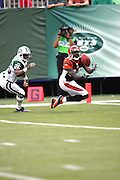 EAST RUTHERFORD, NJ - SEPTEMBER 12:  Wide receiver Chad Johnson #85 of the Cincinnati Bengals catches a touchdown pass while covered by safety Erik Coleman #26 of the New York Jets at Giants Stadium on September 12, 2004 in East Rutherford, New Jersey. The Jets defeated the Bengals 31-24. ©Paul Anthony Spinelli *** Local Caption *** Chad Johnson