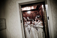 Debutantes in an elevator at the Waldorf Astoria Hotel...The Viennese Opera Ball in New York City is the biggest and most famous of New York's charity balls. Held yearly at the Waldorf Astoria hotel and opened by debutantes and their escorts...In New York City separate worlds coexist without necesseraily ever meeting. Some are virtually closed to outsiders...The world of New York's society often meets in the grand ballrooms of the city's most prestigeous hotels, such as The Pierre, The Plaza and The Waldorf Astoria. They meet at big balls to dine, dance and donate money to charity through auctions held at the balls. Parts of the proceeds from tickets, which are in the range of $1000/person, also go to charity.