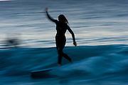 May 30 2011: Female longboarder surfs at Snapper Rocks on the Gold Coast, Queensland, Australia. Photo by Matt Roberts / Nikon