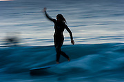 May 30 2011: Female longboarder surfs at Snapper Rocks on the Gold Coast, Queensland, Australia. Photo by Matt Roberts / Nikon