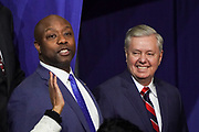 U.S. Senator Tim Scott, left, and Senator Lindsey Graham of South Carolina during the Keep America Great Rally at the in the North Charleston Coliseum February 28 2020 in North Charleston, South Carolina.