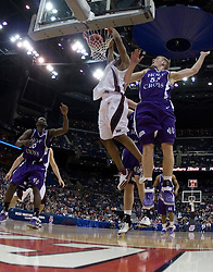 Southern Illinois Salukis forward Randal Falker (14) dunks against Holy Cross Crusaders forward Eric Meister (53).   The #4 seed Southern Illinois Salukis defeated the #13 seed Holy Cross Crusaders 61-51  in the first round of the Men's NCAA Tournament in Columbus, OH on March 16, 2007.