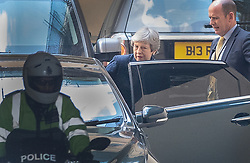 © Licensed to London News Pictures. 16/05/2019. London, UK. Prime Minister Theresa May is watched by her close protection officer (R)  as she leaves Parliament after meeting with the backbench 1922 committe. Photo credit: Peter Macdiarmid/LNP