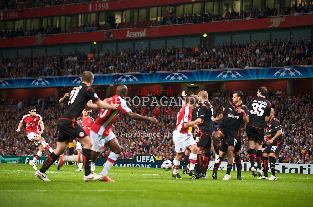 LONDON, ENGLAND - TUESDAY, SEPTEMBER 29th, 2009: Arsenal's Cesc Fabregas takes a free-kick during the UEFA Champions League Group H match at the Emirates Stadium. (Photo by Chris Brunskill/Propaganda)