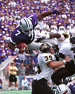 Kansas State quarterback Michael Bishop (7) dives over the Missouri line for a touchdown during game aciton against the Tigers at KSU Stadium in Manhattan, Kansas in 1997.
