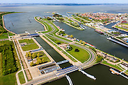 Nederland, Zeeland, Terneuzen, 09-05-2013; Sluizencomplex Terneuzen, de Westsluis of zeesluis.  <br /> Belgie en Nederland zijn overeengekomen een (nieuwe) grote zeesluis Terneuzen te gaan bouwen (geschikt voor schepen van het formaat New Panamax). Woonwijk van Terneuzen (r).<br /> View on the sluices of Terneuzen the West sluice (or Sea sluice. Residential district (r) in the back.<br /> luchtfoto (toeslag op standard tarieven)<br /> aerial photo (additional fee required)<br /> copyright foto/photo Siebe Swart