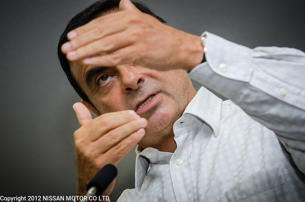 Nissan CEO Carlos Ghosn gestures while speaking to staff at Calsonic Kansei HQ in Saitama City, Japan.