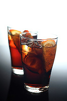 Close-up of cola with ice and lemon