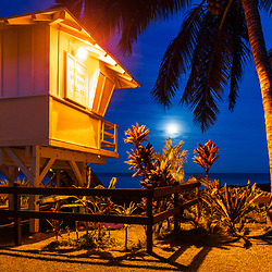 Kihei Maui Kamaole Beach lifeguard tower T2 at night photo with the moon and pacific ocean. Copyright ⓒ 2019 Paul Velgos with All Rights Reserved.