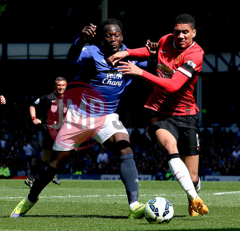 Everton's Romelu Lukaku challenges Chris Smalling of Manchester United   - Photo mandatory by-line: Matt McNulty/JMP - Mobile: 07966 386802 - 26/04/2015 - SPORT - Football - Liverpool - Goodison Park - Everton v Manchester United - Barclays Premier League