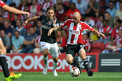 Brentford's Alan McCormack and Charlton Athletic's Rhoys Wiggins - Photo mandatory by-line: Patrick Khachfe/JMP - Mobile: 07966 386802 09/08/2014 - SPORT - FOOTBALL - Brentford - Griffin Park - Brentford v Charlton Athletic - Sky Bet Championship - First game of the season