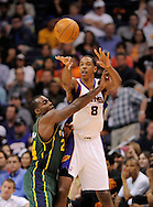 Mar. 14, 2012; Phoenix, AZ, USA; Phoenix Suns forward Channing Frye (8) makes a pass against the Utah Jazz forward Paul Millsap (24) during the second half at the US Airways Center. The Suns defeated the Jazz 120-111. Mandatory Credit: Jennifer Stewart-US PRESSWIRE..