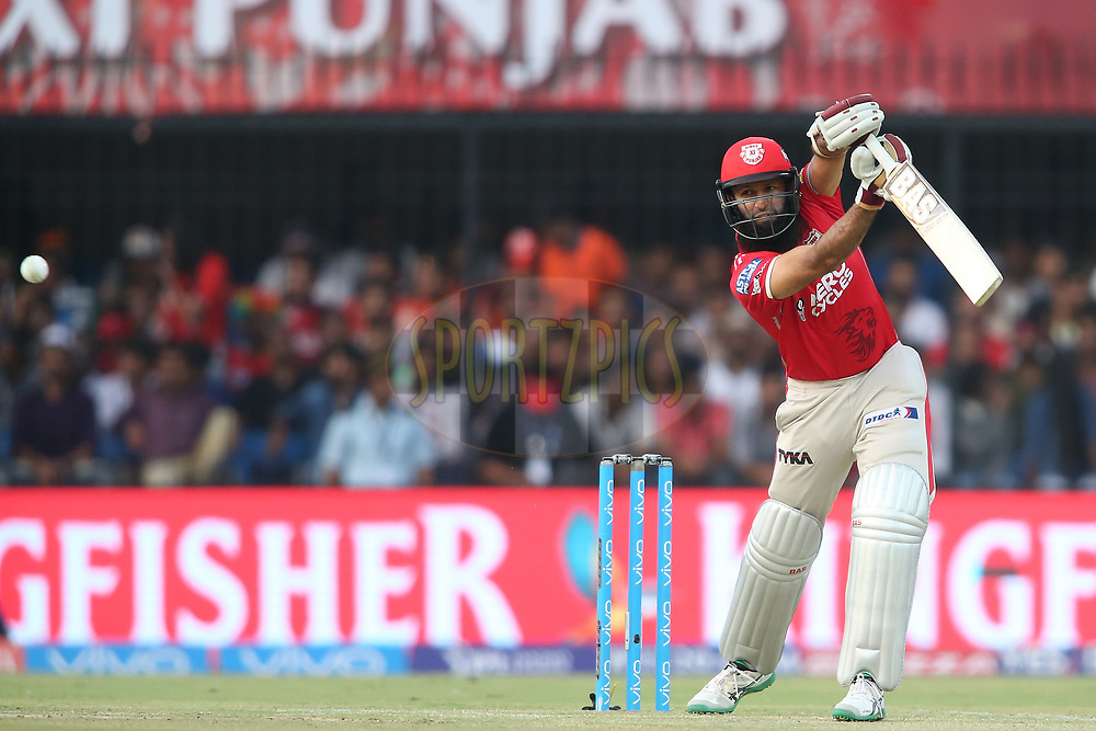 Hashim Amla of Kings XI Punjab drives a delivery on the up through the covers during match 4 of the Vivo 2017 Indian Premier League between the Kings XI Punjab and the Rising Pune Supergiant held at the Holkar Cricket Stadium in Indore, India on the 8th April 2017<br /> <br /> Photo by Shaun Roy - IPL - Sportzpics