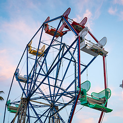 Newport Beach California Balboa Fun Zone Ferris Wheel and toy soldier.  The Ferris Wheel has been a popular attraction in the Balboa Fun Zone since 1936. Newport Beach is a popular coastal city along the Pacific Ocean in Orange County Southern California. Copyright ⓒ 2017 Paul Velgos with All Rights Reserved.