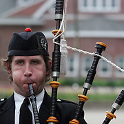 A bagpiper plays a tune prior to graduation ceremonies at Drake University in Des Moines, Iowa.  The private school, which has an enrollment of about 5,000 students, is known for it's fine law school and pharmacy department.