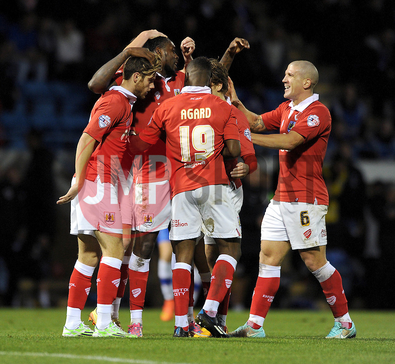 Bristol City's Jay Emmanuel-Thomas celebrates with his team mates after scoring. - Photo mandatory by-line: Dougie Allward/JMP - Mobile: 07966 386802 - 08/11/2014 - SPORT - Football - Gillingham - Priestfield Stadium - Gillingham v Bristol City - FA Cup - Round One