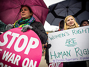 A couple of participants in a rally calling on president Obama to ensure the United States is a leader in providing comprehensive, post-rape care, including safe abortion services, to survivors of sexual violence in conflict carry signs in front of the White House in Washington, DC<br /> <br /> <br /> PHOTOS/John Nelson