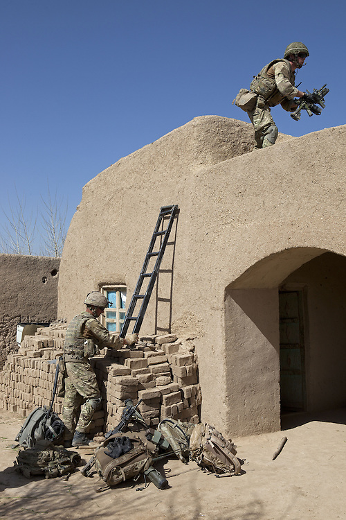 British soldiers of 16 Air Assault Bde's elite BRF (Brigade Reconnaissance Force) searching a compound as part of an operation in the village of Kakaran in Helmand Province, Southern Afghanistan on the 14th of March 2011.