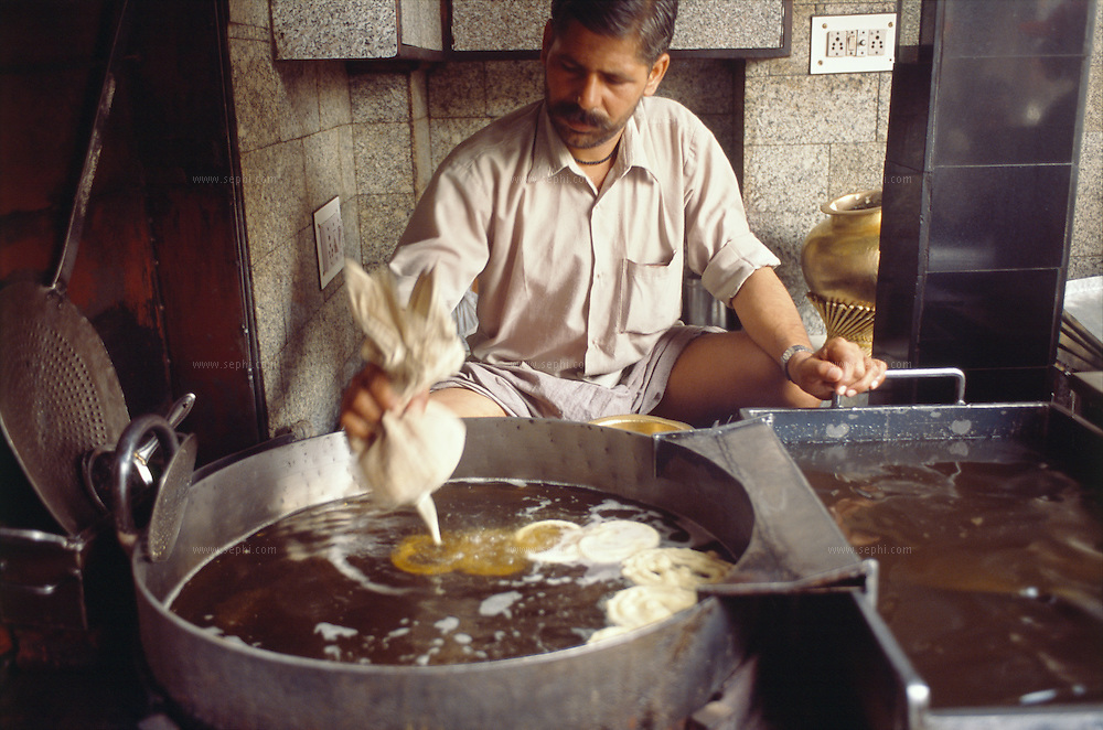 Dariba Jalebi Wale near Chandni Chowk is one of the oldest and most famous places for jalebi in Delhi. the first jalebi of the day, hot and way too sweet for many, is ready to be eaten, golden in color and dripping with syrup, at eight o'clock in the morning.