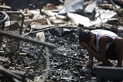 December 12, 2016 - Recife, Brazil - During the morning of Monday (12), a fire hit a favela in the city of Recife. During the morning of Monday (12), the fire hit the favela Vila Santa Luzia, in the city of Recife. Dozens of people had their homes burned by fire and three men had severe burns on their bodies. In Recife, Northeast Brazil, December 12, 2016. (Credit Image: © Diego Herculano/NurPhoto via ZUMA Press)