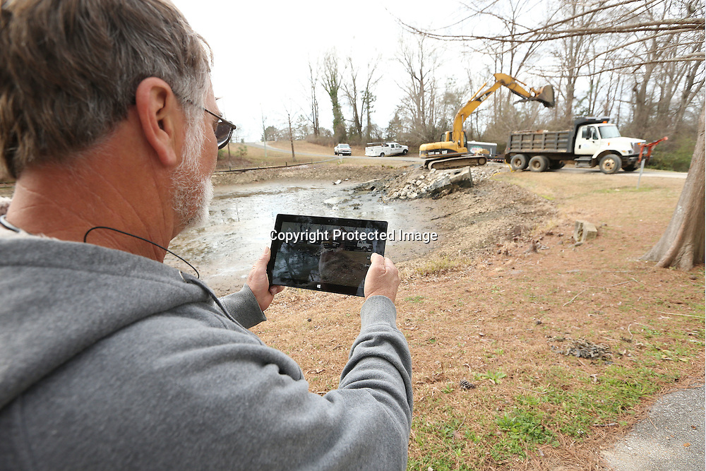 Adam Robison | BUY AT PHOTOS.DJOURNAL.COM<br /> Robert Deese, job superintendent for RCI, over the phase 3 construction at the Elvis Presley Birthplace, takes photos with his tablet to document the jobsite on his first day on the site Tuesday morning in Tupelo.
