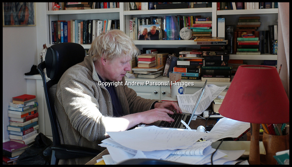 The London Mayor Boris Johnson working on his London Economy Manifesto speech in his office at home in London, before launching the manifesto in Croydon later that morning, Wednesday April 4, 2012. Photo By Andrew Parsons/ i-Images..
