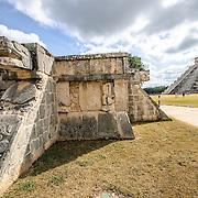 In the foreground is the Venus Platform, used for religious ceremonies, and in the background is the Temple of Kukulkan (El Castillo) at Chichen Itza Archeological Zone, ruins of a major Maya civilization city in the heart of Mexico's Yucatan Peninsula.