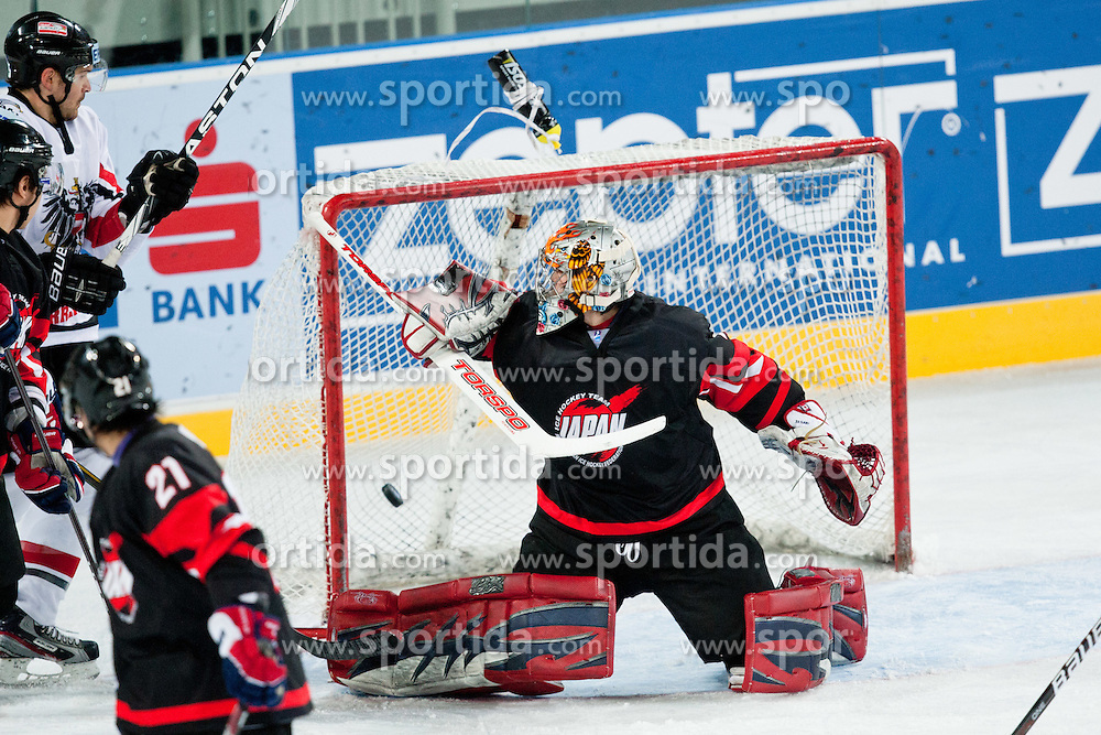 Goalie Yuta Narisawa of Japan watches the puck in the net scoed by Mario Altmann of Austria during ice-hockey match between Austria and Japan at IIHF World Championship DIV. I Group A Slovenia 2012, on April 18, 2012 at SRC Stozice, Ljubljana, Slovenia. (Photo By Matic Klansek Velej / Sportida.com)