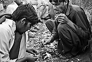 .Along the Peshawar ? Islamabad road addicts prepare heroin for smoking and injecting in full view of passers by on one of the countries busiest roads...Record opium crops in neighbouring Afghanistan have resulted in a cheap, affordable and plentiful supply of heroin and opium in Pakistan...In the frontier town of Peshawar, a gram of heroin sells for 100 rupees, little more than a dollar. Most addicts smoke or ?chase the dragon?, some inject but the inaccessibility of syringes dictate most addicts smoke the drug...Opium can be found in its pure form, fresh from record harvests in Afghanistan. Most is processed into heroin in the many factories along the Afghan / Pakistan borer, but some is retained, especially in the tribal province, for ?traditional medicinal? purposes such as bile din tea for curing arthritis and flu symptoms.