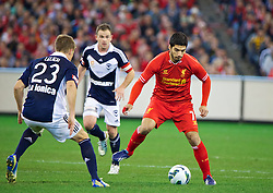 MELBOURNE, AUSTRALIA - Wednesday, July 24, 2013: Liverpool's Luis Suarez in action against Melbourne Victory during a preseason friendly match at the Melbourne Cricket Ground. (Pic by David Rawcliffe/Propaganda)