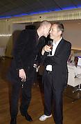 BJ and Terry Jones, I.D. magazine dinner for John Dempsey of Mac cosmetics, Fifth floor restaurant, Harvey Nichols. 17 December 2002. © Copyright Photograph by Dafydd Jones 66 Stockwell Park Rd. London SW9 0DA Tel 020 7733 0108 www.dafjones.com
