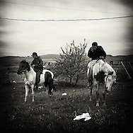Republic of Lakotah.Pine Ridge Indian Reservation, South Dakota..Pine Ridge is the poorest Indian reservation in the United States. Almost have of it's residents live below the poverty line and unemployment is around 80%. ..Two young men after an afternoon ride.