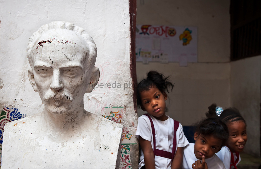 CUBA (La Habana). 2009. Children with a bust of Jose Marti at a primary school in Old Habana. Free education is one of the major developments in Cuban society.