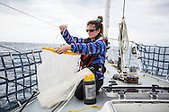 North Atlantic Ocean, September 2014.<br /> First mate Shanley McEntee holds a 200micron neuston net plankton tow, these trawls are used to gather samples on board the Sea Dragon.<br /> &copy; Chiara Marina Grioni
