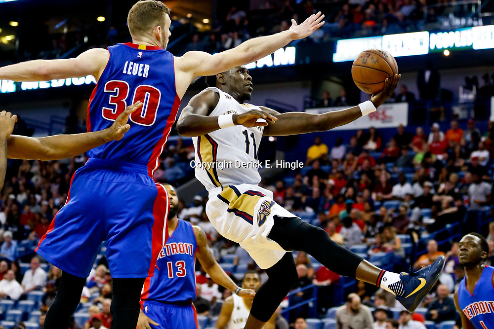 Mar 1, 2017; New Orleans, LA, USA; New Orleans Pelicans guard Jrue Holiday (11) shoots over Detroit Pistons forward Jon Leuer (30) during the second half of a game at the Smoothie King Center. The Pelicans defeated the Pistons 109-86. Mandatory Credit: Derick E. Hingle-USA TODAY Sports