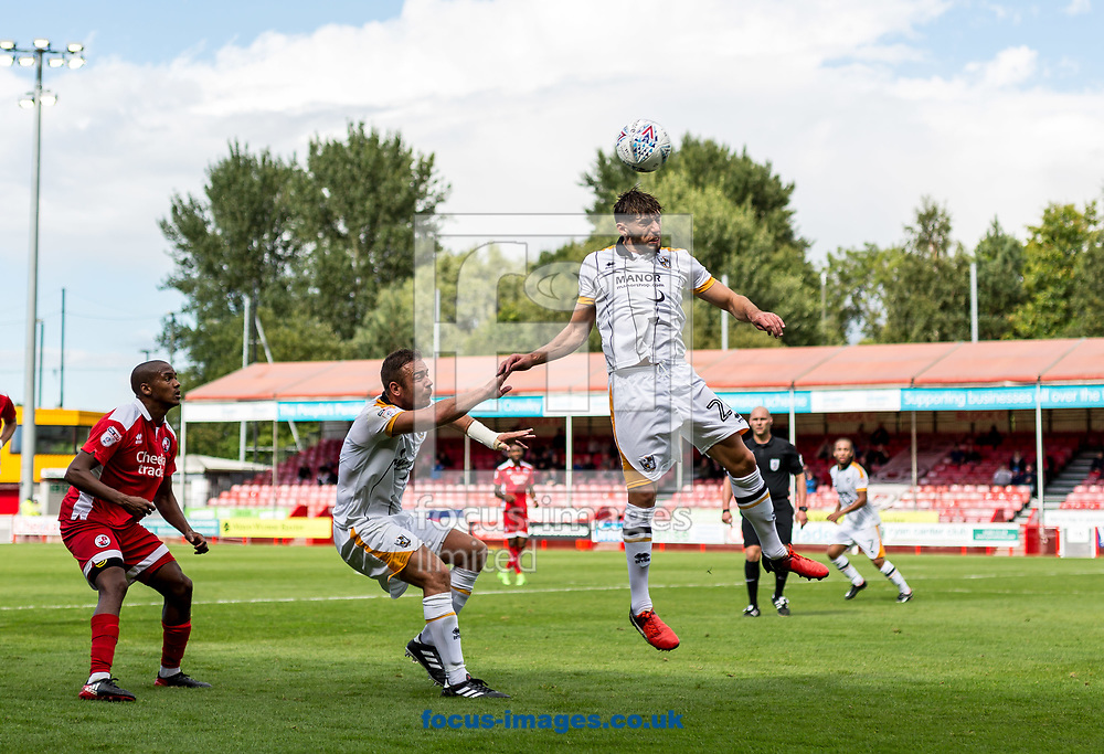 Anthony de Freitas of Port Vale heads during the Sky Bet League 2 match at  Checkatrade.com Stadium, Crawley<br /> Picture by Liam McAvoy/Focus Images Ltd 07413 543156<br /> 05/08/2017