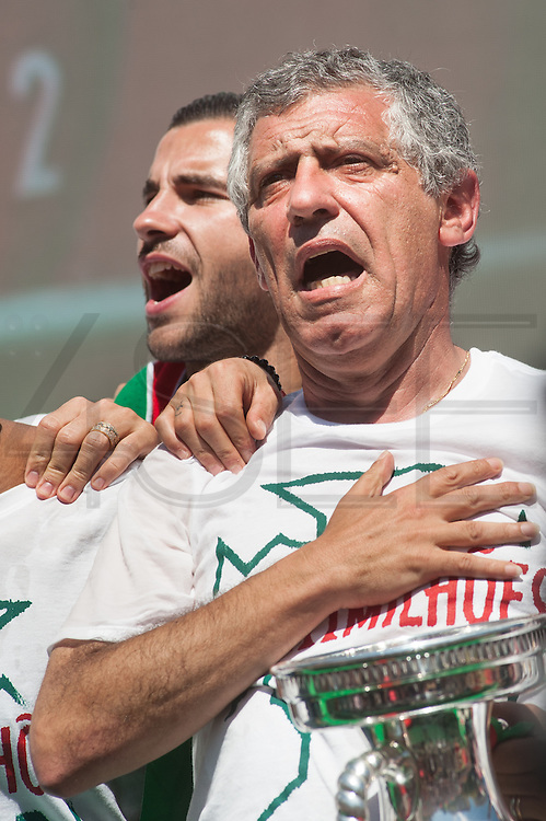 Fernando Santos portuguese coach sings the national anthem with portuguese football players to the crowd of portuguese supporters at Alameda Dom Afonso Henriques, in Lisbon. Portugal's national squad won the Euro Cup the day before, beating in the final France, the organizing country of the European Football Championship, in a match that ended 1-0 after extra-time.