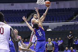September 17, 2018 - Quezon City, NCR, Philippines - Moustafa Ahmed Lashin (White) of Qatar tries to lay-up the ball over Marcio Lassiter (Blue) of the Philippines. (Credit Image: © Dennis Jerome S. Acosta/Pacific Press via ZUMA Wire)