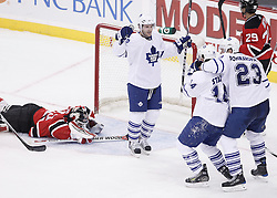 Jan 29, 2010; Newark, NJ, USA; The Toronto Maple Leafs celebrate a goal by Toronto Maple Leafs center Matt Stajan (14) during the third period at the Prudential Center. The Devils won 5-4 in overtime.