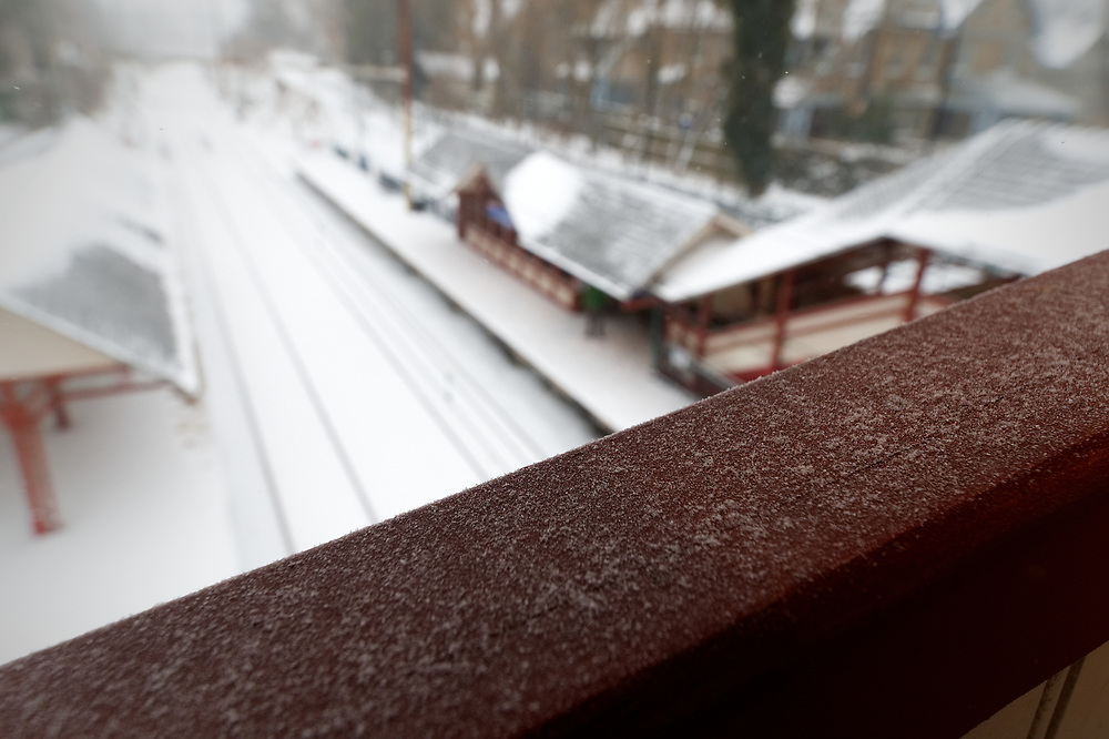 Snow covers a pedestrian bridge railing as trains are delayed when the region feels the impact of the 'Bomb Cyclone' winter storm Grayson, on January 4, 2018, in Philadelphia, PA
