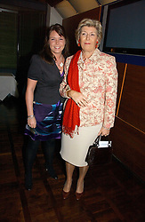 CAROLYN BENSON and her daughter HONOR BENSON at a party to celebrate the publication of 'The year of Eating Dangerously' by Tom Parker Bowles held at Kensington Place, 201 Kensington Church Street, London on 12th october 2006.<br />