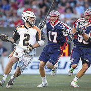 Dave Lawson #2 of the Rochester Rattlers tires to get past Brodie Merrill #17 of the Boston Cannons and Eric Martin #55 of the Boston Cannons with the ball during the game at Harvard Stadium on August 9, 2014 in Boston, Massachusetts. (Photo by Elan Kawesch)