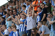 Colchester United fans get behind their team during the Sky Bet League 1 match between Colchester United and Rochdale at the Weston Homes Community Stadium, Colchester<br /> Picture by Richard Blaxall/Focus Images Ltd +44 7853 364624<br /> 08/05/2016