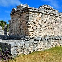 House of the Northwest at Mayan Ruins in Tulum, Mexico<br /> The House of the Northwest is one of the first buildings you see after entering the ruins. The rough masonry is immediately noticeable. This is uncharacteristic of other Mayan sites where the construction consisted of precise stonework. Apparently during the Late Post-Classic Period (1200 to 1539 AD) the facades were covered with colorful stucco which led to less refined structures.