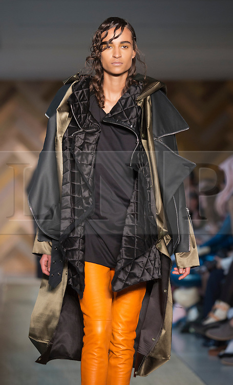 © Licensed to London News Pictures. 29/05/2014. London, England. Collection by Zoe Waters. 30 students of the Royal College of Art's prestigious MA Fashion programme presented their final collections in  a runway show at the RCA building in Kensington. Photo credit: Bettina Strenske/LNP