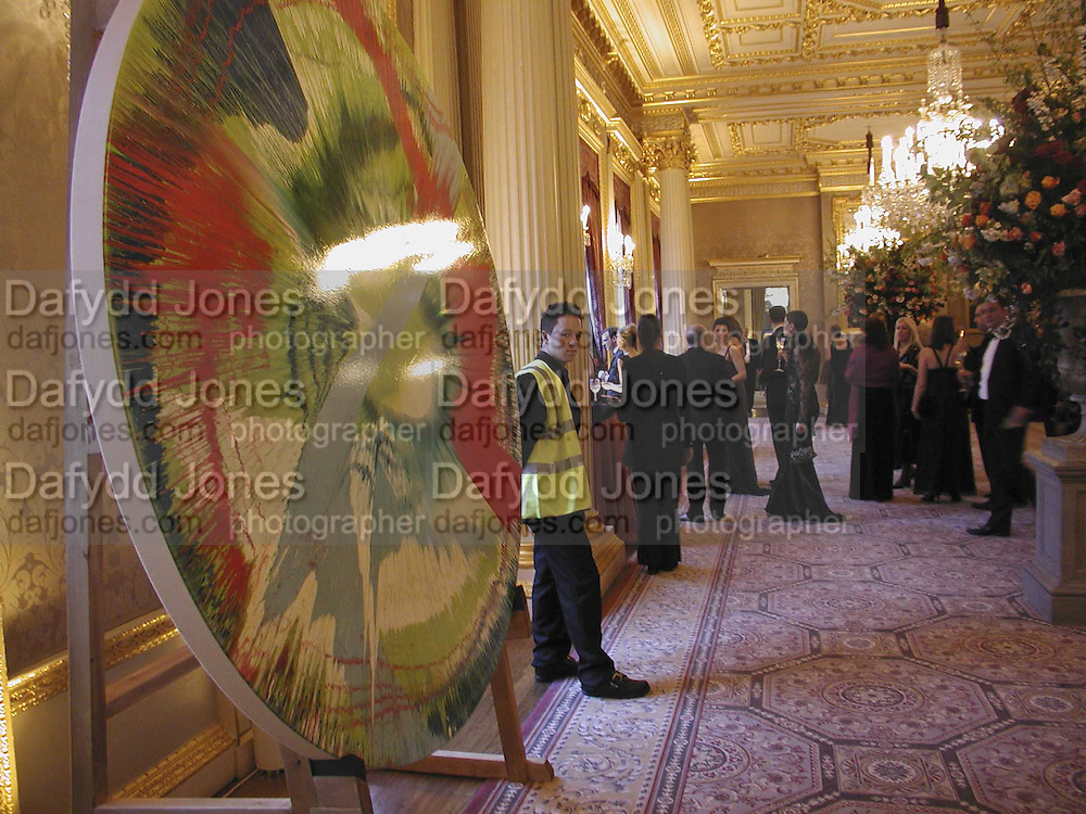 Damien Hirst Spin painting, Ark Gala Dinner, Marlborough House, London. 5 May 2006. ONE TIME USE ONLY - DO NOT ARCHIVE  © Copyright Photograph by Dafydd Jones 66 Stockwell Park Rd. London SW9 0DA Tel 020 7733 0108 www.dafjones.com