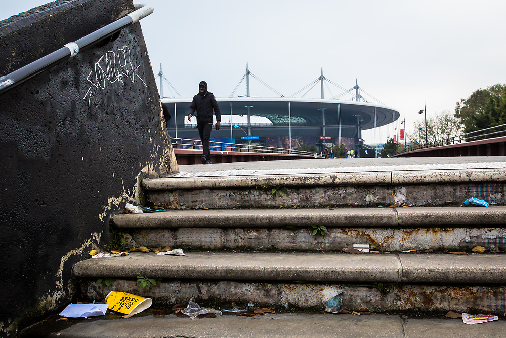 A man walks past the Stade de France Stadium near Paris, one year after three Islamic State (IS) terrorists committed an attack outside the stadium using explosives.  Saint Denis, France.  November 13, 2016.