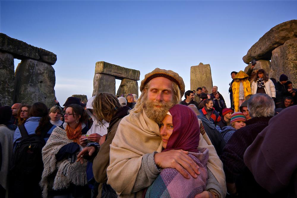 Sunrise at Stonehenge on the Summer Solstice.  20,000 revelers wait to greet the sunrise at Stonehenge.