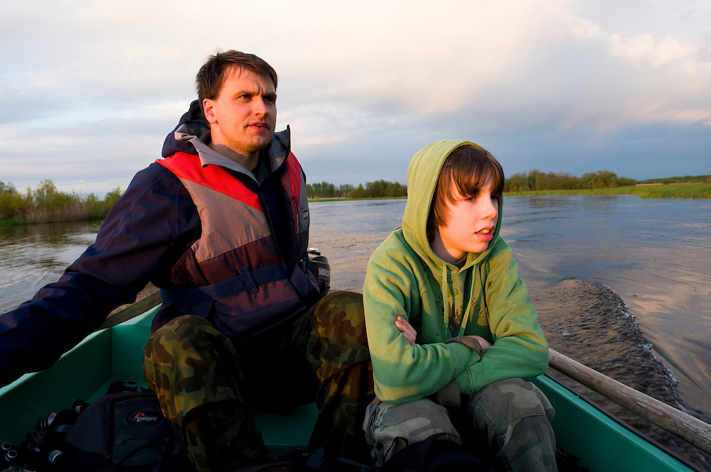 Man and boy out in boat on Suur Emajogi, Estonia